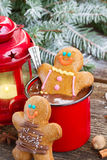 Gingerbread men with mug of hot chocolate Stock Photo