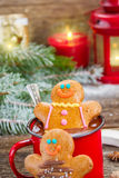 Gingerbread men with mug of hot chocolate Royalty Free Stock Photo