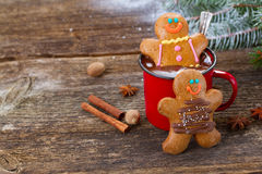 Gingerbread men with mug of hot chocolate Royalty Free Stock Image