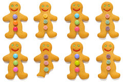 Gingerbread men odd one out. Smiling gingerbread men with one exception, isolated on a white background Royalty Free Stock Images