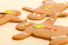 Gingerbread Men on Parchment Paper Stock Images