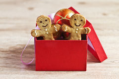 Gingerbread men in the red box. On the wooden table Stock Images