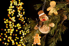 Gingerbread men in the tree Stock Image