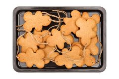 Gingerbread men on white Royalty Free Stock Photos