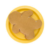 Gingerbread men on a yellow paper plate top view Stock Images