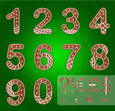 Gingerbread numbers and symbols. Green background Royalty Free Stock Photography