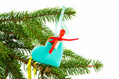 Gingerbread ornaments hanging on afir branch Royalty Free Stock Photo