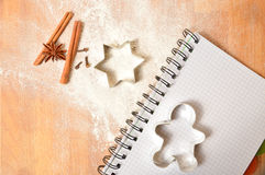 Gingerbread pastry cutters on wooden cutting board. Christmas li Royalty Free Stock Photo