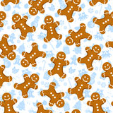 Gingerbread pattern. Seamless pattern with gingerbread men and Christmas icons Royalty Free Stock Image