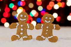 Gingerbread people with blurry christmas lights Royalty Free Stock Photography