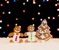 Gingerbread people and christmas tree Stock Photos
