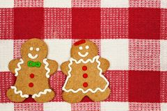 Gingerbread people on a red and white checked cloth background Stock Photo