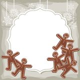 Gingerbread people on retro frame Stock Image