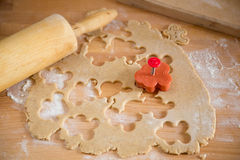 Gingerbread preparations in kitchen, rolling pin and shape cutter Royalty Free Stock Photo