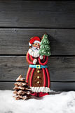 Gingerbread santa claus chocolate christmas tree on heap of snow against wooden background Stock Photography