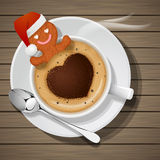 Gingerbread with santa claus hat in cup of hot coffee Stock Images