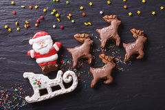 Gingerbread Santa on a sleigh pulled by reindeers. horizontal to Royalty Free Stock Image