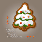 Gingerbread in shape of a fir and handwritten words. Xmas greeting card with a gingerbread in a shape of a fir tree decorated colored icing and handwritten Stock Photography