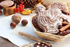 Gingerbread in the shape of a rooster and biscuits Stock Images