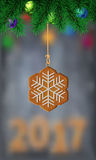 Gingerbread snowflake on christmas tree. Vector illustration on blurred background with number of 2017 Stock Photography