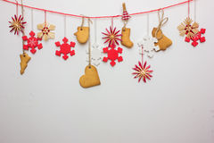 Gingerbread snowflakes hung from a tree on a string. White background. Royalty Free Stock Photos