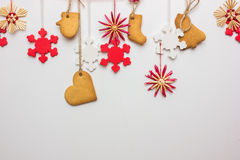 Gingerbread snowflakes hung from a tree on a string Royalty Free Stock Images