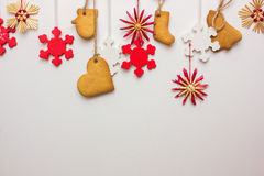 Gingerbread snowflakes hung from a tree on a string. Royalty Free Stock Images
