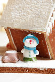 Gingerbread snowman. Homemade gingerbread house and snowman Stock Photography