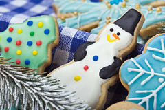Gingerbread snowman and Christmas cookies. Smiling gingerbread snowman and Christmas cookies Stock Photography