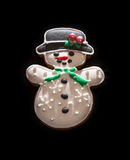 Gingerbread snowman on the dark background, Christmas theme Stock Photo