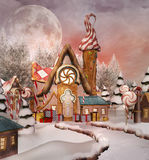 Gingerbread snowy village. Fantasy village with gingerbread house and candies Royalty Free Stock Photography