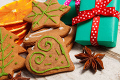Gingerbread with spices and gifts for Christmas on old wooden background, christmas time Stock Images