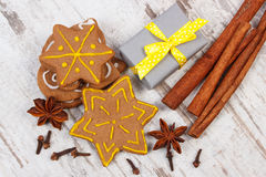 Gingerbread with spices and gifts for Christmas on old wooden background, christmas time Stock Photo