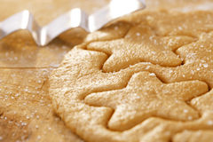 Gingerbread  star cookie cuts dough Royalty Free Stock Photography