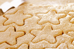 Gingerbread  star cookie cuts dough Stock Photography