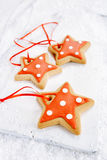 Gingerbread star cookies on white wood and  snow background Stock Photo