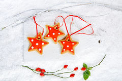 Gingerbread star cookies on white wood and  snow background Royalty Free Stock Photo