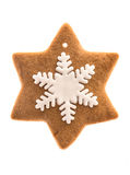 Gingerbread star shaped cookie with icing snowflake. Isolated on white background. traditional christmas sweet food stock image