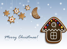 Gingerbread stars and house on snow background. Gingerbread stars half moon and chocolate house on snow background with decorations christmas card Stock Image