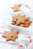 Gingerbread stars on tea towel Royalty Free Stock Photos