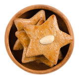 Gingerbread stars in wooden bowl over white Stock Image