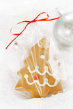 Gingerbread tree cookie in a bag on white  snow background Royalty Free Stock Image
