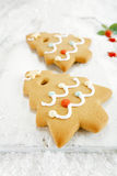 Gingerbread tree cookies on white wood and  snow background Royalty Free Stock Images