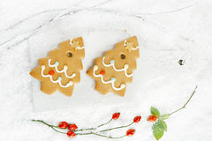 Gingerbread tree cookies on white wood and  snow background Stock Photos