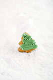 Gingerbread tree on a festive Christmas snow background, nice po Royalty Free Stock Photography