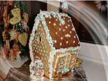 Gingerbread tree and gingerbread house stock image