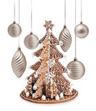 Gingerbread tree and Xmas silver decoration Stock Photos