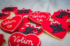 Valentines day gingerbread with cats and love you signs. Gingerbread valentines day cake with two black cats and love you signs in serbian language Royalty Free Stock Images