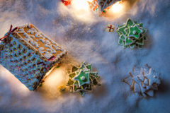 Gingerbread village with Christmas tree and gifts Stock Photos
