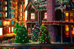 Gingerbread village with houses and buildings and decorative Christmas trees royalty free stock photography